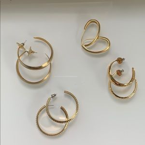 four sets of gold earrings